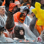 Rain-soaked fans cheer during the second quarter of an NFL football game between the Cleveland Browns and San Diego Chargers Sunday, Oct. 28, 2012, in Cleveland. (AP Photo/Phil Long)