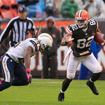 Cleveland Browns tight end Benjamin Watson (82) avoids San Diego Chargers safety Atari Bigby in the fourth quarter of an NFL football game Sunday, Oct. 28, 2012, in Cleveland. On cold, rainy …