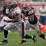 Tampa Bay Buccaneers running back Carnell Williams (24) runs past Cleveland Browns safety T.J. Ward (43) during the fourth quarter an NFL football game Sunday, Sept. 12, 2010, in Tampa, Fla. …