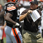 Cleveland Browns head coach Eric Mangini, right, screams at Marcus Benard after a first quarter play during an NFL football game against the Tampa Bay Buccaneers Sunday, Sept. 12, 2010, in T …