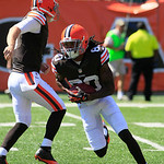 Cleveland Browns wide receiver Travis Benjamin gets a hand off from quarterback Brandon Weeden (3) in the first half of an NFL football game against the Cincinnati Bengals, Sunday, Sept. 16, …