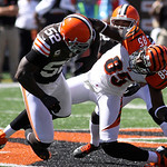 Cincinnati Bengals wide receiver Armon Binns (85) is hit by Cleveland Browns middle linebacker D'Qwell Jackson (52) and defensive back Buster Skrine in the first half of an NFL football game …