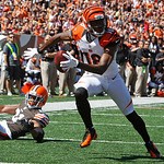 Cincinnati Bengals wide receiver A.J. Green (18) scores a touchdown on a pass reception in the first half of an NFL football game against the Cleveland Browns, Sunday, Sept. 16, 2012, in Cin …