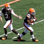 Cleveland Browns quarterback Brandon Weeden (3) hands off to running back Trent Richardson (33) in the first half of an NFL football game against the Cincinnati Bengals, Sunday, Sept. 16, 20 …