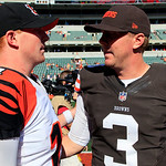 Cincinnati Bengals quarterback Andy Dalton (14) meets with Cleveland Browns quarterback Brandon Weeden (3) after the Bengals' 34-27 win in an NFL football game, Sunday, Sept. 16, 2012, in Ci …