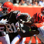 Cleveland Browns tight end Alex Smith (81) is pursued by Cincinnati Bengals linebacker Manny Lawson (99) in the first half of an NFL football game, Sunday, Sept. 16, 2012, in Cincinnati. (AP …