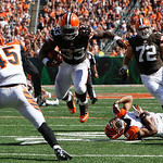 Cleveland Browns running back Trent Richardson (33) avoids a tackle on his way to a 23-yard touchdown on a pass reception in the second half of an NFL football game against the Cincinnati Be …