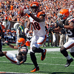 Cincinnati Bengals wide receiver A.J. Green (18) scores on a pass reception past Cleveland Browns cornerback Dimitri Patterson (21) and strong safety T.J. Ward (43) in the first half of an N …