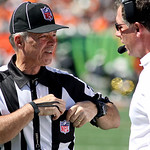 Side judge Marty Peters, left, talks with Cleveland Browns head coach Pat Shurmur in the first half of an NFL football game against the Cincinnati Bengals, Sunday, Sept. 16, 2012, in Cincinn …