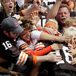 Fans pound the back of Cleveland Browns wide receiver Josh Cribbs after a 65-yard touchdown reception in the second quarter of an NFL football game against the Kansas City Chiefs Sunday, Sep …