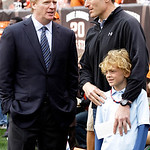 NFL Commissioner Roger Goodell, left, talks with Cleveland Indians general manager Mark Shapiro, standing with his son Caden, before the Cleveland Browns took on the Kansas City Chiefs in an …