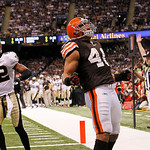 Cleveland Browns running back Peyton Hillis (40) celebrates his rushing touchdown as New Orleans Saints safety Darren Sharper (42) walks away in the first quarter of their NFL football game  …
