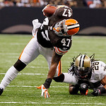 Cleveland Browns fullback Lawrence Vickers (47) is tackled by New Orleans Saints safety Usama Young (28) during the first half of an NFL football game at the Louisiana Superdome in New Orlea …