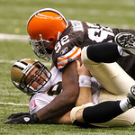 Cleveland Browns defensive tackle Shaun Rogers (92) lies on top of New Orleans Saints quarterback Drew Brees (9) after a hurried pass in the second half of an NFL football game at the Louisi …