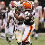 Cleveland Browns cornerback Sheldon Brown (24) intercepts a Drew Brees pass intended for New Orleans Saints wide receiver Robert Meachem, background, during the second quarter of an NFL foot …