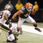 Cleveland Browns running back Peyton Hillis (40) rushes against New Orleans Saints cornerback Malcolm Jenkins (27) and  safety Usama Young (28) during the second half of an NFL football game …