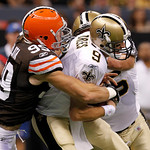 New Orleans Saints quarterback Drew Brees (9) is sacked by Cleveland Browns linebacker Scott Fujita (99) during the first quarter of an NFL football game at the Louisiana Superdome in New Or …