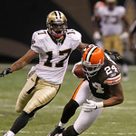 Cleveland Browns cornerback Sheldon Brown (24) intercepts a Drew Brees pass intended for New Orleans Saints wide receiver Robert Meachem (17), background, during the second quarter of an NFL …