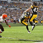 Pittsburgh Steelers safety Ryan Clark, center, comes down with an interception intended for Cleveland Browns wide receiver Mohammed Massaquoi, left, in the third quarter of an NFL football g …