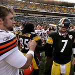Pittsburgh Steelers quarterback Ben Roethlisberger (7) meets Cleveland Brows quarterback Derek Anderson, left, at the center of Heinz Field after a 27-14 Steelers win in an NFL football game …