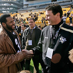 Retired Pittsburgh Steelers running back Jerome Bettis, left, visits with NHL hockey Hall-of-Famer Mario Lemieux, owner of the Pittsburgh Penguins, on the sidelines at Heinz Field before a N …