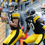 Pittsburgh Steelers receiver Hines Ward, left, hauls in a 51-yard touchdown pass from quarterback Ben Roethlisberger as teammate Santonio Holmes (10) blocks Cleveland Browns' Eric Wright, ri …