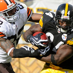 Pittsburgh Steelers running back Rashard Mendenhall (34) runs around right end past Cleveland Browns' Brandon McDonald (22) for 11-yards in the third quarter of an NFL football game in Pitts …