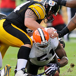 Cleveland Browns' Alex Hall (51) beats Pittsburgh Steelers center Doug Legursky, top, to a fumble by Steelers quarterback Ben Roethlisberger in the first quarter of an NFL football game in P …