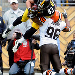 Pittsburgh Steelers tight end Heath Miller (83) is upended by Cleveland Browns' David Bowens (96) after catching an eight-yard touchdown pass from quarterback Ben Roethlisberger in the secon …
