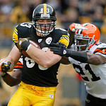 Pittsburgh Steelers tight end Heath Miller, left, runs past Cleveland Browns defensive back Brodney Pool after making a catch in the second quarter of an NFL football game in Pittsburgh,  Su …