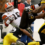Pittsburgh Steelers safety Ryan Clark, lower left, upends Cleveland Browns' Joshua Cribbs (16) during the first quarter of an NFL football game in Pittsburgh Sunday, Oct. 18, 2009. (AP Photo …