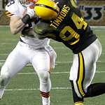 Pittsburgh Steelers linebacker Lawrence Timmons (94) tackles Cleveland Browns tight end Evan Moore during the fourth quarter of an NFL football game  in Pittsburgh, Thursday, Dec. 8, 2011. ( …