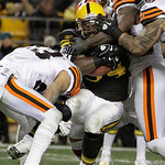 Pittsburgh Steelers running back Rashard Mendenhall (34) is tackled by Cleveland Browns cornerback Joe Haden, left, and linebacker D'Qwell Jackson, second from right, in the second quarter o …