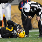 Pittsburgh Steelers quarterback Ben Roethlisberger (7) is checked by referee Ed Hoculi after he was injured in the second quarter of the NFL football game against the Cleveland Browns on Thu …