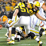 Cleveland Browns quarterback Colt McCoy (12) dives for the end zone as he is hit by Pittsburgh Steelers outside linebacker James Harrison (92) in the first quarter of the NFL football game o …
