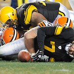 Pittsburgh Steelers quarterback Ben Roethlisberger (7) winces as he is injured after being hit by Cleveland Browns nose tackle Scott Paxson (69) in the second quarter of the NFL football gam …