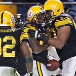 Pittsburgh Steelers cornerback William Gay, center, is greeted by defensive end Cameron Heyward, right, after making an interception in the fourth quarter of an NFL football game against the …