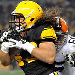 Pittsburgh Steelers strong safety Troy Polamalu (43) is hit by Cleveland Browns offensive guard Shawn Lauvao (66) as he returns an interception in the second quarter of an NFL football game  …