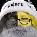 A Pittsburgh Steelers fan dressed as Santa watches an NFL football game against the Cleveland Browns in Pittsburgh, Thursday, Dec. 8, 2011. (AP Photo/Gene J. Puskar)