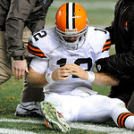 Cleveland Browns quarterback Colt McCoy (12) holds his hand after being hit by Pittsburgh Steelers outside linebacker James Harrison, not pictured, during the fourth quarter of an NFL Footba …