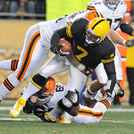 Pittsburgh Steelers quarterback Ben Roethlisberger (7) is injured as Cleveland Browns nose tackle Scott Paxson (69) and nose tackle Brian Schaefering (91), top, hit him in the second quarter …