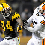 Cleveland Browns free safety Mike Adams (20) grabs Pittsburgh Steelers wide receiver Antonio Brown (84) after he made a catch in the NFL football game on Thursday, Dec. 8, 2011, in Pittsburg …