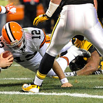 Cleveland Browns quarterback Colt McCoy (12) dives for the end zone as he is hit by Pittsburgh Steelers outside linebacker James Harrison (92) in the first quarter of the NFL football game T …