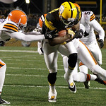 Pittsburgh Steelers wide receiver Jerricho Cotchery (89) center, breaks through Cleveland Browns cornerback Dimitri Patterson (21), left,  on his way to a touchdown after making a catch in t …
