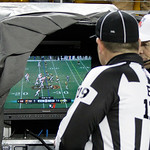 Officials look at a replay on the sidelines during the fourth quarter of an NFL football game between the Pittsburgh Steelers and Cleveland Browns in Pittsburgh, Thursday, Dec. 8, 2011. (AP  …