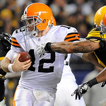 Cleveland Browns quarterback Colt McCoy (12) evades the rush from the Pittsburgh Steelers defense in the third quarter of the NFL football game on Thursday, Dec. 8, 2011, in Pittsburgh. (AP  …