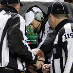 Referee Ed Hochuli , center, exits a replay booth on the sidelines during the fourth quarter of an NFL football game between the Pittsburgh Steelers and Cleveland Browns in Pittsburgh, Thurs …