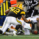 Cleveland Browns middle linebacker D'Qwell Jackson (52) recovers a fumble by Pittsburgh Steelers tight end Heath Miller (83) (not seen) ain front of Pittsburgh Steelers tight end Weslye Saun …