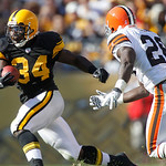Pittsburgh Steelers running back Rashard Mendenhall (34) runs past Cleveland Browns safety Abram Elam (26) for a first down in the fourth quarter of the NFL football game Sunday, Oct. 17, 20 …