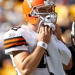 Cleveland Browns quarterback Colt McCoy wipes his face on the sidelines during the fourth quarter of an NFL football game against the Pittsburgh Steelers, Sunday, Oct. 17, 2010, in Pittsburg …